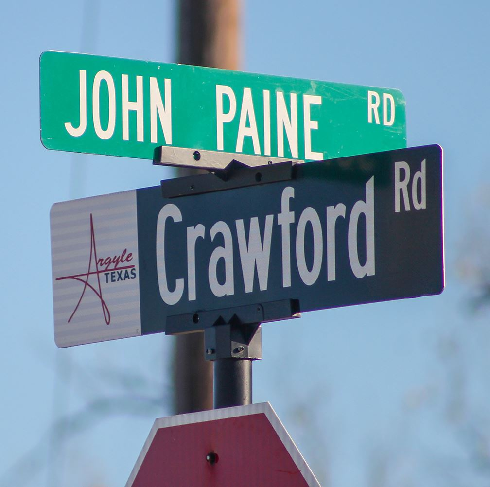 Signs display the intersection of Crawford Road at John Paine Road.